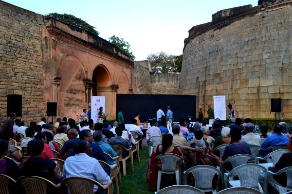 People gathered inside the bangalore fort for a music concert.