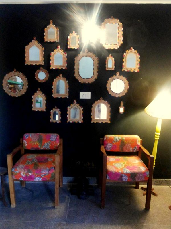 Gujarathi Leather mirrors and kantha chairs