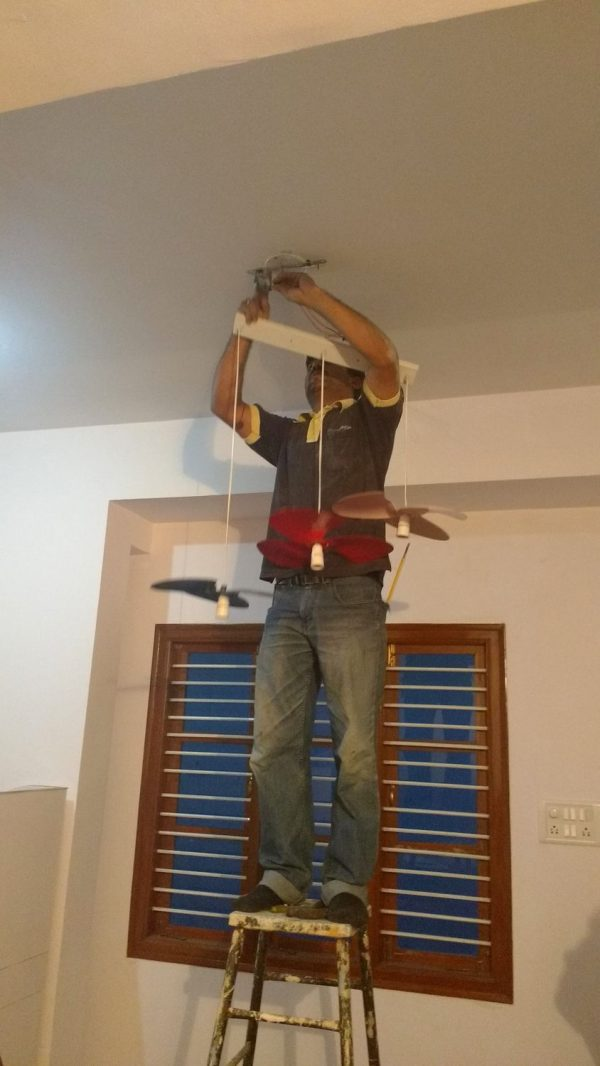 The electrician connecting the wires