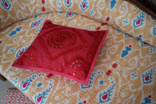 Ethnic Indian Decor. Mirror work pillow cover with kantha upholstery couch.