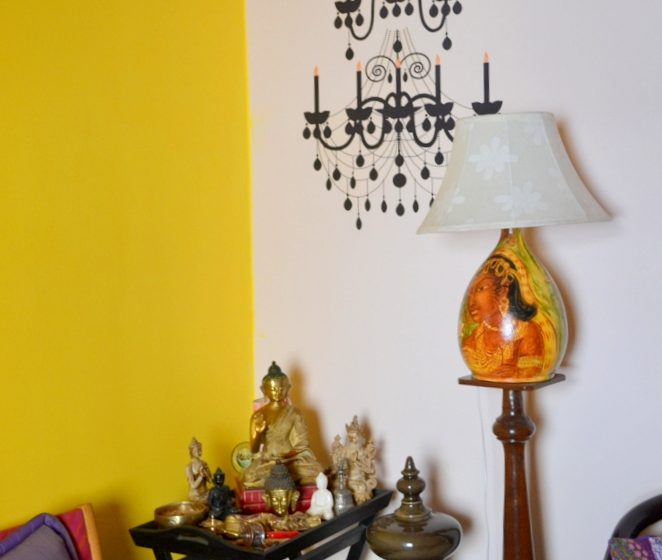 A Buddha corner with a chandelier decal