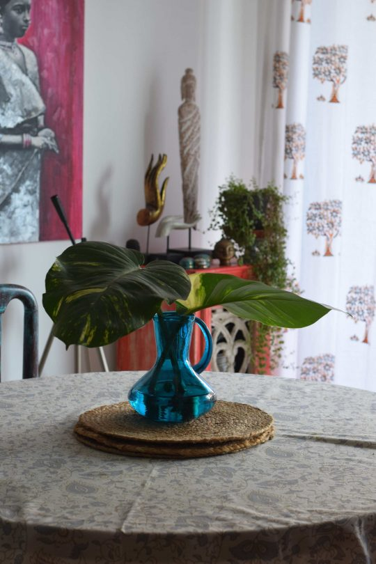 A handblown glass vase on the dining table.
