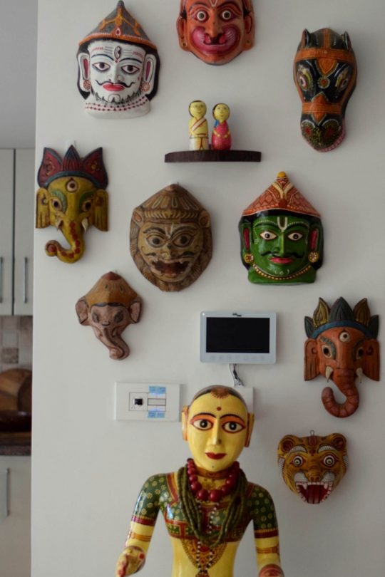 Close up of the mask wall in the home of Preethi Prabhu