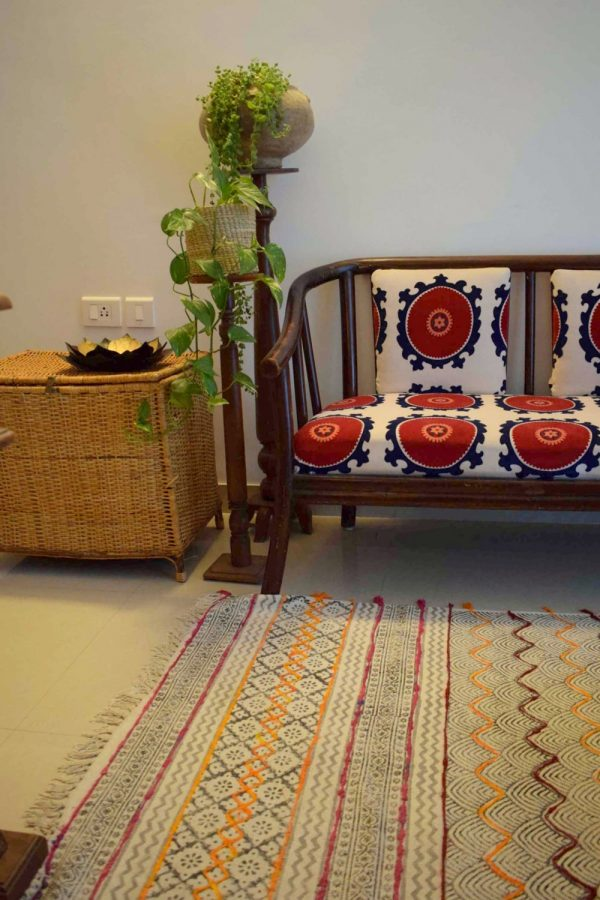 The office Room seating. Block printed rug and printed suzani upholstery from Jaipur.