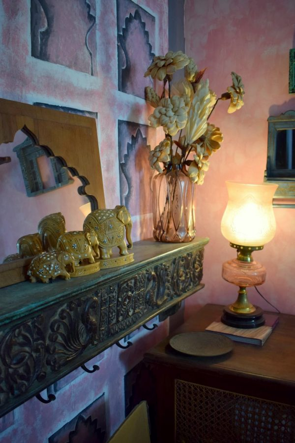Inlay elephants on a carved shelf. At home with preethi prabhu