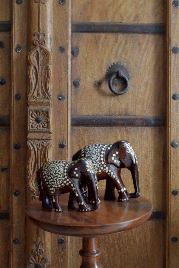 Rosewood elephants with inlay work.
